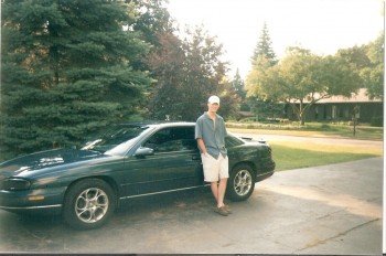 While I don't have any pictures of our first date, this is an earlier photo that shows Matt with the car he picked me up on on our first date.  Fond memories!  I loved that car and thought it was one of the coolest cars in town :)