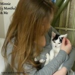 A cell phone photo my friend Becky took of Me holding kitten Minnie at Christmas.